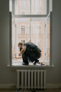 Reactive maintenance-showing man repairing window